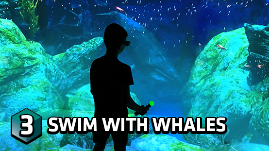 Take a swim underwater with the holographic whales!